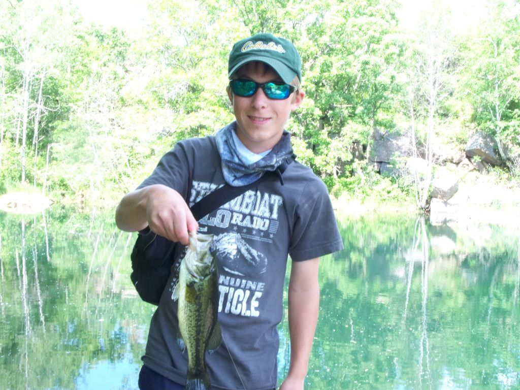 fly caught largemouth bass from an abandoned granite quarry